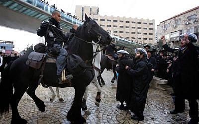 Hundreds of ultra-Orthodox clash with Israeli police during a protest in Jerusalem on February 6, 2014, following the arrest of a Haredi draft-dodger. (photo credit: Yonatan Sindel/Flash90)