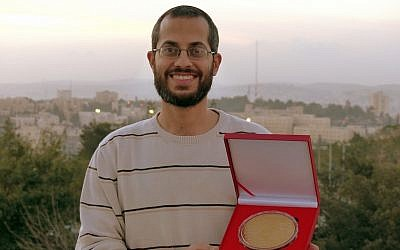 Yossi Kabessa shows off his gold medal (Photo credit: Courtesy)