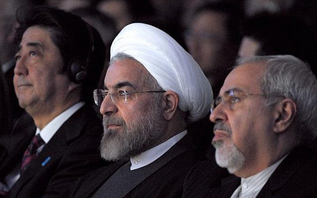 Iranian President Hassan Rouhani, center, and Foreign Minister Mohammad Javad Zarif, right, are seen during the World Economic Forum in Davos, Switzerland, on January 22, 2014. (photo credit: AFP/Eric Piermont)