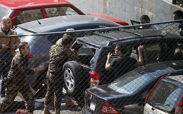 Lebanese security forces dismantle a car bomb in a parking lot in Corniche al-Mazraa, in Beirut, on February 12, 2014 (photo credit: AFP/Anwar Amro)