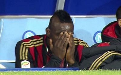 Mario Balotelli cries on AC Milan's bench, Saturday, February 9, 2014 (screen capture: YouTube)