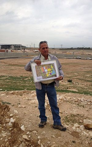 Bnei Shimon Regional Council head Moshe Paul with the plans of the industrial park (photo credit: Mitch Ginsburg/ Times of Israel)
