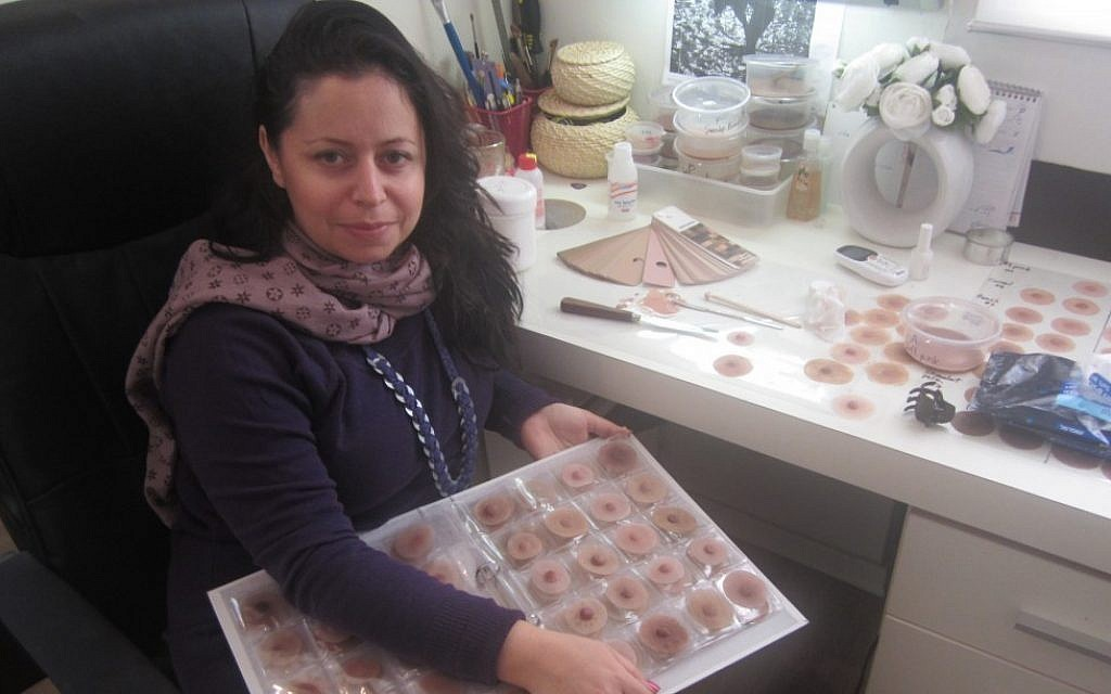 Michelle Kolath-Arbel shows off a selection of prosthetic nipples (photo credit: Ben Sales/JTA)