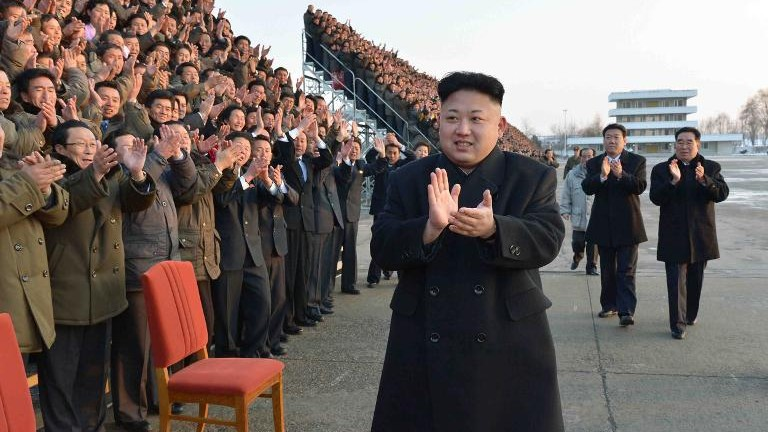 Undated photo released by North Korea's official Korean Central News Agency (KCNA) on February 11, 2014 shows Kim Jong-Un (C) during the national conference of subworkteam leaders in the agricultural sector in an undisclosed location in North Korea (photo credit: KCNA via KNS/AFP/File)