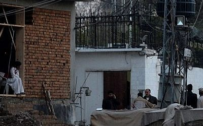 Pakistani security personnel gather outside the Iranian consulate following a suicide bomb attack in Peshawar on February on February 24, 2014. (photo credit: AFP PHOTO/ A Majeed)