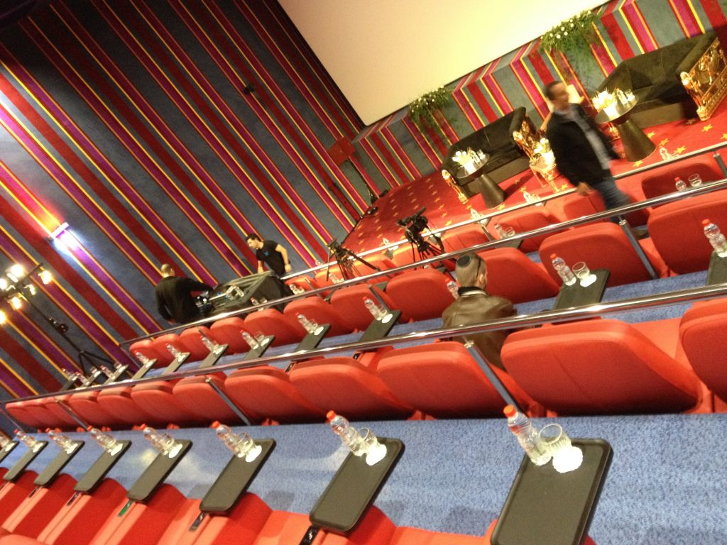 Red leather stadium seats, carpeted walls and personal snack trays in one of the VIP screening rooms (photo credit: Jessica Steinberg/Times of Israel)