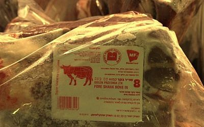 Illustrative: Kosher meat slaughtered in Poland  bears the symbol of the Warsaw rabbinate. (JTA)