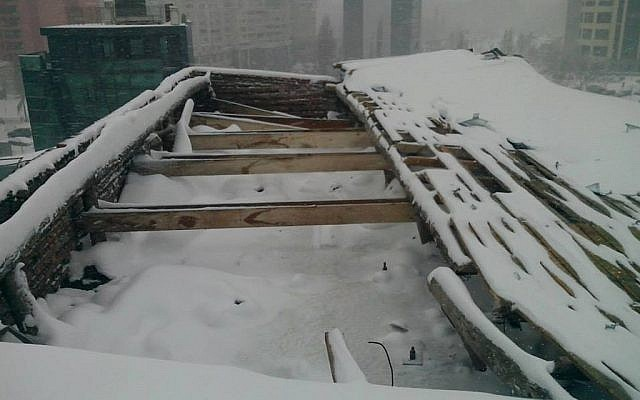The roof of Bucharest's Jewish State Theater collapsed under the weight of snow on Jan. 25, 2014. (The Jewish State Theater of Bucharest/JTA)