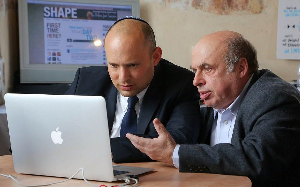 Minister of Diaspora Affairs Naftali Bennett (left) and Jewish Agency Chairman Natan Sharansky (right) join an 'online jam session' in Jerusalem, February 2014. (Sasson Tiram)