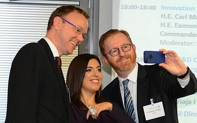 (L. to R.) Sweden's Ambassador to Israel Carl Magnus, Tzav 8 co-founder Yael Shany, and Ireland's Ambassador to Israel Eamonn McKee take a 'high-tech selfie' at the Tzav 8 event in Netanya. (photo credit: Courtesy)