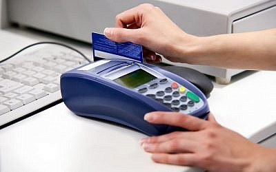 Illustration: Credit card in use.  via Shutterstock