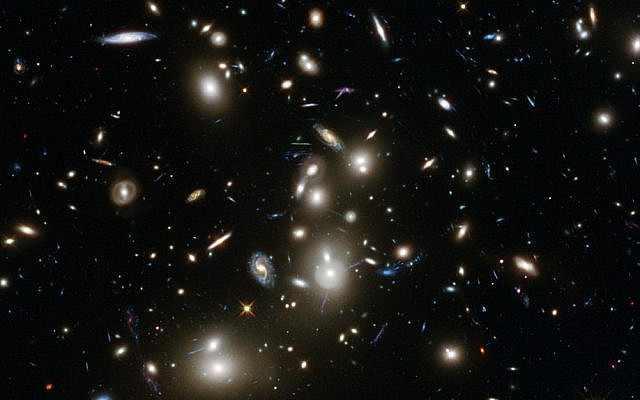 Image of the Abell 2744 galaxy cluster, taken by NASA's Hubble telescope  on January 7, 2014. (photo credit: CC BY NASA)