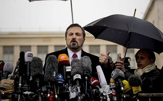 Louay Safi, center, spokesperson for the Syrian National Coalition, Syria's main political opposition group, gestures during a press briefing at the United Nations headquarters in Geneva, Switzerland, Switzerland, Monday, Feb 10, 2014.  (AP Photo/Anja Niedringhaus)