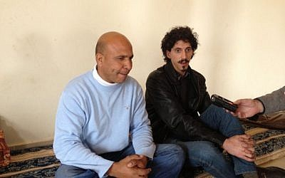 Abed Tarrabin, left, alongside a translator and employee of MediaCentral (photo credit: Mitch Ginsburg/ Times of Israel)