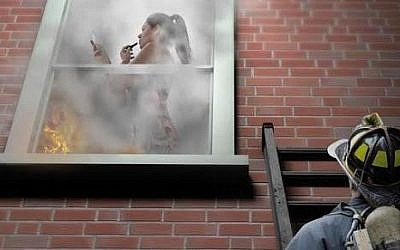 This ad from New-Pharm, featuring a women fixing her makeup while her house burns, made the list. (photo credit: Courtesy of WIZO)