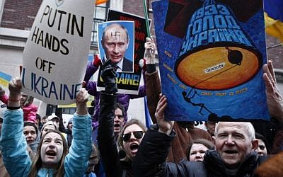 People take part during a protest in front on the Russian Consulate against Russian military intervention in the Crimea region of Ukraine, on March 2, 2014, in New York City (Photo credit: Kena Betancur/Getty Images/AFP)