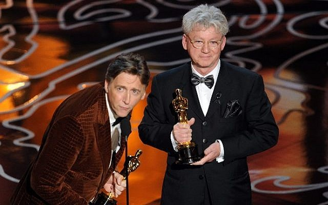 Filmmakers Nick Reed (L) and Malcolm Clarke accept the Best Documentary, Short Subject award for 'The Lady In Number 6' onstage during the Oscars at the Dolby Theatre on March 2, 2014 in Hollywood, California. (photo  credit: AFP/Kevin Winter/Getty Images)