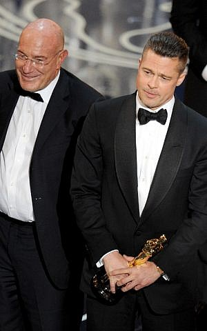 Producer Arnon Milchan (L) and actor/producer Brad Pitt accept the Best Picture award for '12 Years a Slave' onstage during the Oscars at the Dolby Theater on Sunday, March 2, 2014 in Hollywood, California (photo credit: Kevin Winter/Getty Images/AFP)