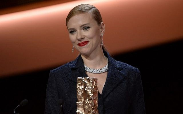 Scarlett Johansson smiles on stage after being awarded with an honorary award during the 39th edition of the Cesar awards ceremony in Paris on February 28, 2014 (photo credit: AFP/Martin Bureau)