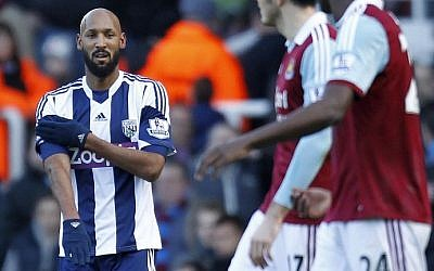 West Bromwich Albion's French striker Nicolas Anelka celebrates with a quenelle after scoring a goal, Dec. 28, 2013 (photo credit: AFP/Ian Kington)