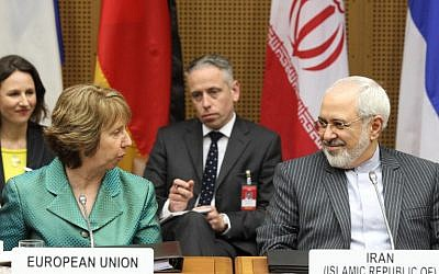 Catherine Ashton (L), High Representative of the Union of Foreign Affairs and Security Policy for the European Union, and Iranian Foreign Minister Mohammad Javad Zarif attend the first day of the second round of P5+1 talks with Iran at the UN headquarters in Vienna, Austria on March 18, 2014. (photo credit: AFP PHOTO / DIETER NAGL)