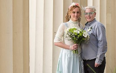 Nikki Pettit (L) and Tanya Ward (R) pose for photographs after their wedding ceremony in Brighton, southern England on Saturday, March 29, 2014 shortly after new gay marriage laws took effect. (photo credit: AFP/Leon Neal)