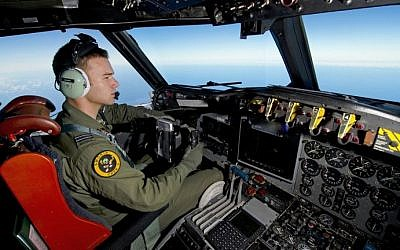 A handout photo taken on March 19, 2014 shows Royal Australian Air Force pilot Flight Lieutenant Russell Adams flying his AP-3C Orion over the Southern Indian Ocean during the search for missing Malaysia Airlines flight MH370. (photo credit: AFP/Australian Defense/Sgt. Hamish Paterson)