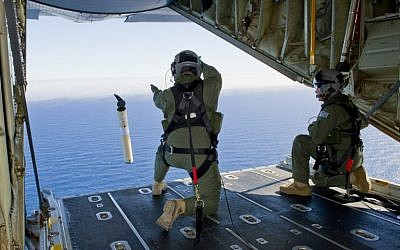 File photo: Royal Australian Air Force troops aboard a C-130J Hercules aircraft in the southern Indian Ocean participate in the multi-nation search for Malaysia Airlines flight MH370. (AFP/Australian Defense/Leading Seaman Justin Brown)