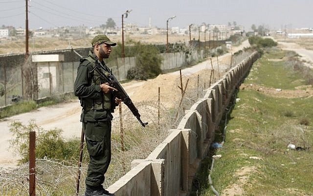A member of the Palestinian security forces, loyal to Hamas, stands guard along the border between Egypt and the Gaza Strip on March 5, 2014. (photo credit: AFP PHOTO/ SAID KHATIB)