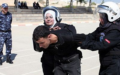 Palestinian policewomen take part in a training session that aims at preparing a special women's unit to intervene during riots, in the West Bank city of Jericho (Photo credit: Abbas Momani/AFP)