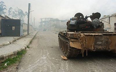 A tank on a street in the town of Zara, in the province of Homs, during fighting between Syrian forces and rebels, Saturday, March 8, 2014 (photo credit: AFP/STR)