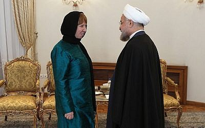 A handout picture released by the official website of the Iranian president shows the Islamic Republic's President Hassan Rouhani meeting with EU foreign policy chief Catherine Ashton on March 9, 2014 in Tehran. (photo credit: AFP/HO/ PRESIDENT.IR)
