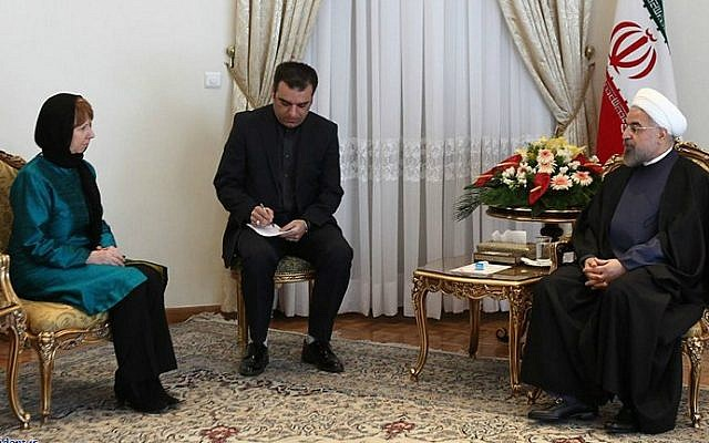 A handout picture released by the official website of the Iranian president shows the Islamic Republic's President Hassan Rouhani (R) meeting with EU foreign policy chief Catherine Ashton (L) on March 9, 2014 in Tehran. (photo credit: AFP PHOTO / HO / PRESIDENT.IR)