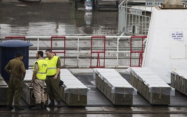 IDF troops inspect boxes of M-302 rockets that were unloaded from the Panamanian-flagged Klos-C vessel on March 9, 2014 at the southern Israeli port of Eilat. (photo credit: Jack Guez/AFP)