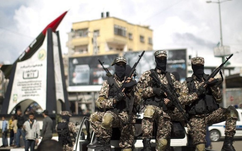 Hamas gunmen in Gaza City on March 10, 2014 (photo credit: AFP/Mahmoud Hams)