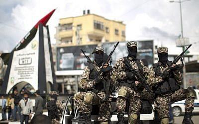 Hamas gunmen in Gaza City on March 10, 2014 (photo credit: AFP/Mahmoud Hams)