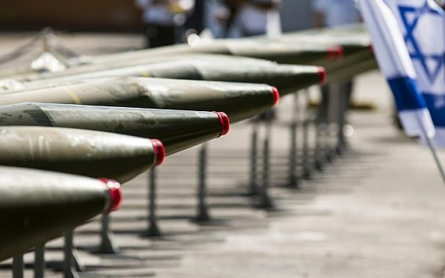 Some of the 40 rockets put on display by the IDF along the docks of the southern port of Eilat, Monday, March 10, 2014 (photo credit: AFP/Jack Guez)