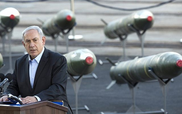 Prime Minister Benjamin Netanyahu speaks in Eilat on March 10, with the Iranian missile shipment behind him (photo credit: AFP/Jack Guez)