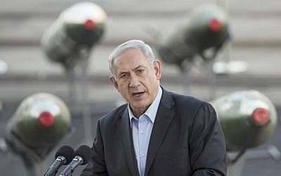 Prime Minister Benjamin Netanyahu speaks to the press at southern port of Eilat, Monday, March 10, 2014, as Israel displayed advanced M-302 rockets that were unloaded from the Panamanian-flagged Klos-C vessel (photo credit: AFP/ Jack Guez)