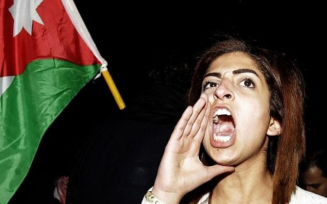 A Jordanian woman shouts anti-Israeli slogans during a protest in front of the Israeli Embassy in Amman, Jordan, on March 10, 2014 (photo credit: AFP/Khalil Mazraawi)