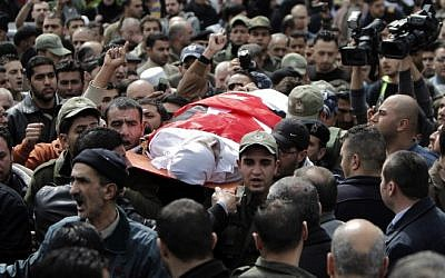 Palestinians carry the body of Raed Zeiter, 38, during his funeral in the northern West Bank city of Nablus, on March 11, 2014 (photo credit: AFP PHOTO /AHMAD GHARABLI)
