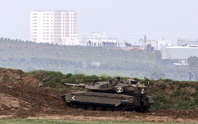 An Israeli army tank is seen stationed on the border between Israel and the Gaza Strip on March 13, 2014. (AFP/Jack Guez)