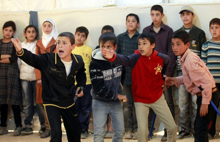 Syrain refugee children perform King Lear, one of Shakespeare's great tragedies, at the sprawling Zaatari refugee camp in Jordan, March 8, 2014 (photo credit: AFP/Khalil Mazraawi)