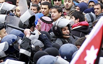 Jordanian riot police confront protesters during a demonstration in front of the Israeli Embassy in Amman on Friday (photo credit: AFP/Khalil Mazraawi)