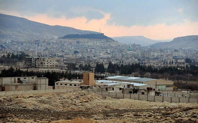 A handout picture released on March 15, 2014, by the official Syrian Arab News Agency (SANA) reportedly shows the city of Yabrud after the Syrian army advanced in the key rebel bastion. (photo credit: AFP PHOTO/HO/SANA)