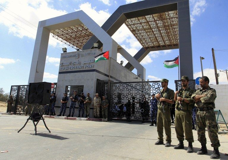 Members of Hamas' security forces standing guard in front of the Rafah border crossing with Egypt in the southern Gaza Strip, September 16, 2013. (photo credit: AFP PHOTO/SAID KHATIB)