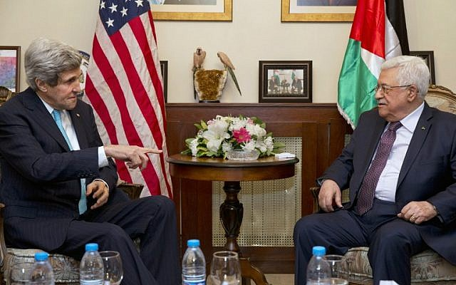 US Secretary of State John Kerry (L) meets with Palestinian Authority President Mahmud Abbas in the Jordanian capital Amman, on Wednesday, March 26, 2014 (photo credit: AFP/Jacquelyn Martin/POOL)