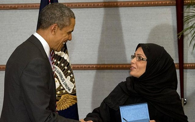 US President Barack Obama (L) presents Dr. Maha Al-Muneef, founder and executive director of the National Family Safety Program, with the Secretary of State's International Women of Courage Award in Riyadh, Saudi Arabia, on March 29, 2014. (photo credit: AFP/Saul Loeb)