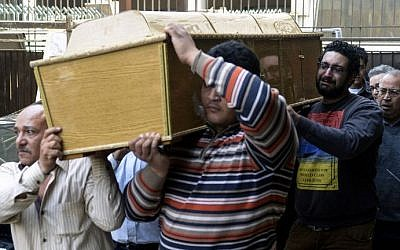 The coffin of one of the victims of Friday's clashes in the neighborhood of Ein Shams, Cairo, Egypt is carried outside the Zinhom Morgue outside the city on March 29, 2014. (photo credit: AFP PHOTO / MOHAMED EL-SHAHED