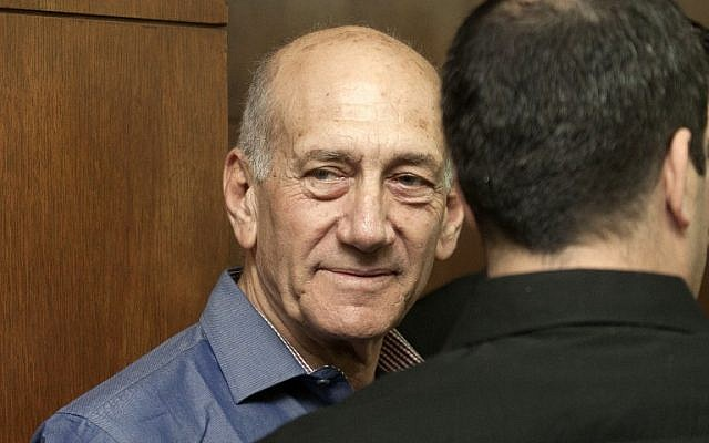 Former prime minister Ehud Olmert at the Tel Aviv District Court, Monday, March 31, 2014 (photo credit: AFP/POOL/Dan Balilty)